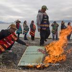 Lummi Tribe Burns Symbolic Check